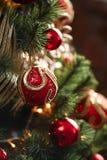 Röda och gula garneringar för julträd Royaltyfri Fotografi