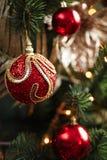 Röda och gula garneringar för julträd Fotografering för Bildbyråer