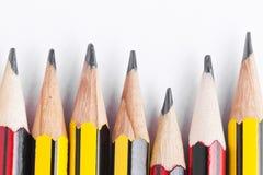 Röda och gula randiga blyertspennor Royaltyfri Fotografi
