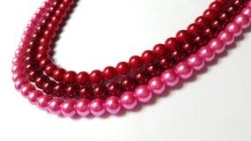 3 röda och rosa Neckalce för rödbruna rader, Arkivfoton