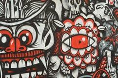 Röda och svarta grafitti Arkivfoto