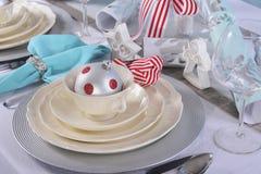 Röda och vita jul för Aqua, bordlägger inställningen Fotografering för Bildbyråer