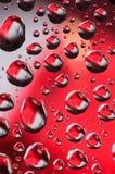 Röda och vita små droppar Fotografering för Bildbyråer