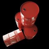 Röda olje- trummor som isoleras på svart bakgrund Royaltyfri Fotografi