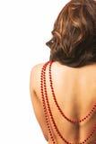 Röda pärlor på baksida Royaltyfri Foto