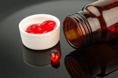röda pills Arkivfoto