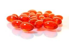 röda pills för gruppgelmakro Arkivbilder