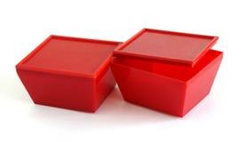 Röda plast- askar Royaltyfri Fotografi