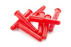Röda plast- låspinnar Arkivfoton