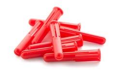 Röda plast- låspinnar Royaltyfria Bilder