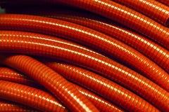 Röda plast-slangar Arkivfoto