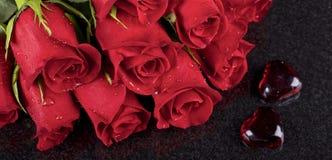 Röda rosor arkivfoto