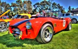 1965 röda Shelby Cobra Arkivbild