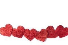 Röda skinande hjärtor på vit bakgrund Royaltyfria Foton