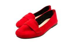 Röda skor på vit bakgrund Royaltyfri Fotografi