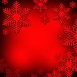 Röda snöflingor på rött och svart royaltyfri foto