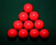 Röda snookerbollar på tabellen Fotografering för Bildbyråer