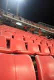 Röda stadionplatser Fotografering för Bildbyråer