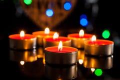 Röda stearinljus ljus med steg Arkivbilder