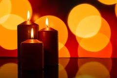 Röda stearinljus och ljus som bokeh Royaltyfria Foton