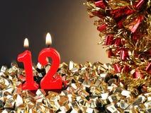 Röda stearinljus som visar Nr 12 Royaltyfri Bild
