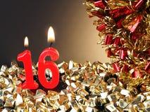 Röda stearinljus som visar Nr 16 Royaltyfri Fotografi