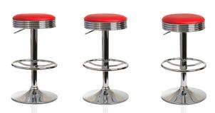 Röda stolar för amerikansk matställe Arkivbilder