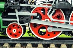 Röda stora tokiga hjul Fotografering för Bildbyråer