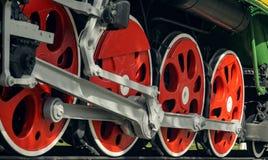 Röda stora tokiga hjul Royaltyfri Fotografi