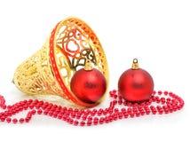 Röda struntsaker för jul, gul klocka och pärlor Royaltyfria Bilder