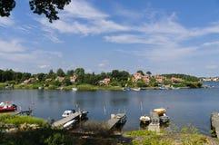Röda stugor i Brandaholm, Sverige Royaltyfria Bilder