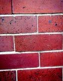 Röda tegelstenar av en vägg Fotografering för Bildbyråer