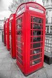Röda telefonaskar Arkivfoton