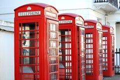Röda telefonaskar i London Royaltyfri Fotografi