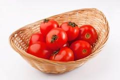 Röda tomater i korgen Royaltyfri Fotografi
