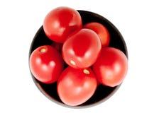 Röda tomater på en platta Royaltyfri Fotografi