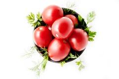 Röda tomater på en platta Royaltyfri Foto