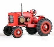 Röda Toy Tractor Isolated på vit Fotografering för Bildbyråer