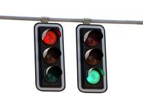 Röda trafikljus och grön over white Arkivbilder