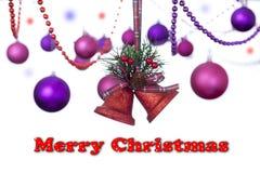 Röda två blänker klockor som hänger på ett tartanband med julstruntsaker med ett snöig tecken för glad jul Royaltyfri Foto