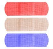 Röda vita och blåa bandaids royaltyfri foto