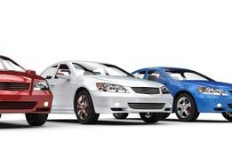 Röda vita och blåa bilar Arkivbild