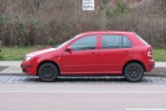 Röda Volkswagen Golf Royaltyfria Foton