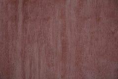 Rödaktig dekorativ grungetextur för golv eller för vägg inom en byggnad arkivbild