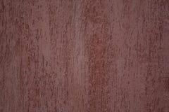 Rödaktig grov grungetextur för golv inom en byggnad royaltyfri fotografi