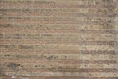 Rödaktig tegelstentextur för konstig forntida vägg fotografering för bildbyråer
