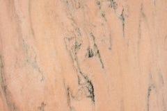 rödaktig textur för marmor Royaltyfria Bilder