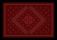 Rödbrun lyxig orientalisk matta med den kulöra prydnaden i mitt Royaltyfria Bilder