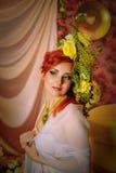 Rödhårig flicka med idérikt smink Royaltyfri Foto
