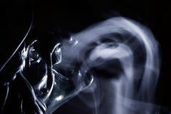 Röka jäkel Fotografering för Bildbyråer